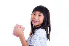 Asian girl holding pink pastel cup and smiling Royalty Free Stock Photos