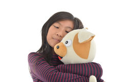 Asian girl holding puppy doll on white Stock Photography