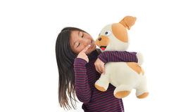Asian girl holding puppy doll on white Royalty Free Stock Photo