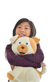 Asian girl holding puppy doll on white Royalty Free Stock Image