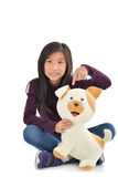 Asian girl holding puppy doll on white Royalty Free Stock Photos