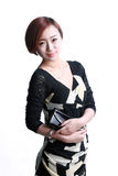 Asian girl holding a purse Royalty Free Stock Image