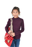 Asian girl holding red bag over white Stock Images