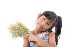 Asian girl holding rice plant with love on white Stock Image