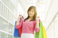 Asian girl holding shopping bags Stock Photos