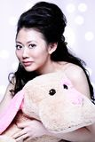 Asian girl holding stuff animal Royalty Free Stock Image