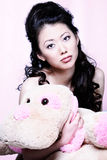Asian girl holding stuff animal Royalty Free Stock Photography
