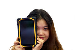 Asian girl holding a tablet in hands Royalty Free Stock Photo