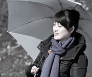 Asian girl holding umbrella against the sun Royalty Free Stock Images