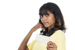 Asian girl holding a white card Stock Photos