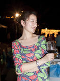 Asian girl holding wine glass at the night Stock Photography