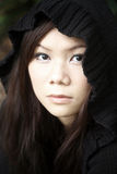 Asian girl with a hood Royalty Free Stock Photo