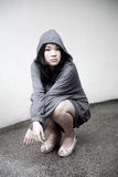 Asian girl in a hooded jacket Royalty Free Stock Images