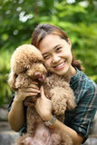 Asian girl hug with her poodle dog Royalty Free Stock Image