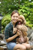 Asian girl hug with her poodle dog Stock Photo