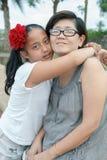 Asian girl hug on mother stock images