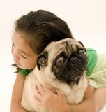Asian Girl Hugging Pet Stock Photo