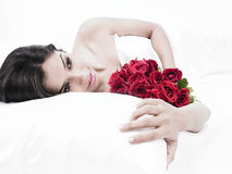 Asian Girl In Bed With A Bunch Of Roses Royalty Free Stock Image