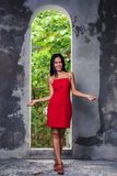 Asian Girl In Red Dress Posing In Abandoned Building Royalty Free Stock Images