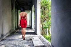 Asian Girl In Red Dress Walking In Abandoned Building Stock Photos