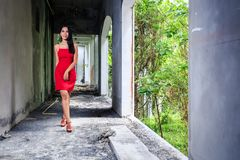 Asian Girl In Red Dress Walking In Abandoned Building Royalty Free Stock Photos