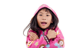 Asian girl in jacket with hood on white. Royalty Free Stock Photo