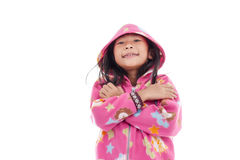 Asian girl in jacket with hood on white. Royalty Free Stock Photography
