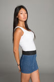 Asian girl in jeans skirt Royalty Free Stock Photos