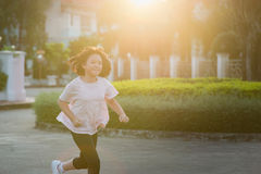 Asian girl  jogging in sunny bright light Stock Photography