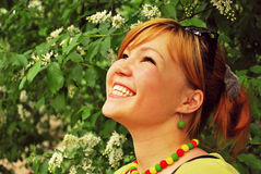 Asian girl joyfully laughs Stock Photo