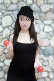Asian girl juggling two balls Royalty Free Stock Image