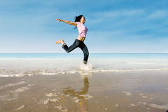 Asian girl jump at beach Royalty Free Stock Photos