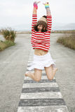 Asian girl jumping with joy Royalty Free Stock Images