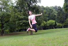 Asian girl jumps. High in a park Stock Photography
