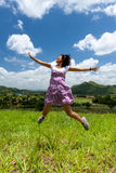 Asian girl jumps Stock Photo