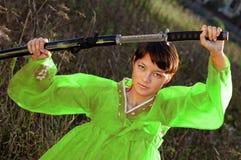 Asian girl with katana Stock Images