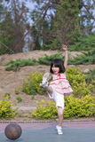 Asian Girl Kicking Basketball Royalty Free Stock Images
