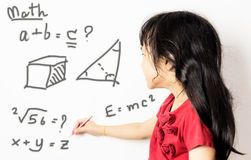 Asian girl kid is confusing with maths. Stock Photo