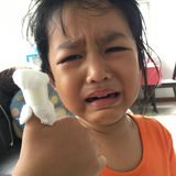 Asian girl kids crying with bandage on finger stock images
