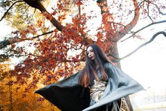 Asian girl in kimono on background of red maple. Asian girl in kimono on a background of red maple Royalty Free Stock Photo