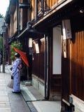 Kanazawa, Japan - September 28, 2015: Girl in kimono with red umbrella in Higashi Chaya old geisha district royalty free stock photos
