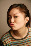 Asian girl kissing at viewer Royalty Free Stock Photos