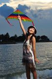 Asian Girl with kite under the sun Royalty Free Stock Photography