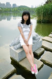 Asian girl on the lake path Royalty Free Stock Images