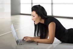 Asian girl with laptop Stock Photos