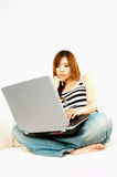 Asian girl with laptop Royalty Free Stock Photos