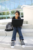 Asian Girl on Laptop at School Royalty Free Stock Image
