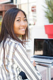 Asian girl and laptop Royalty Free Stock Images