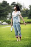 Asian girl on the lawn Stock Photos