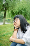 Asian girl on the lawn Stock Images